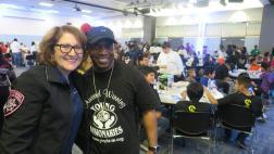 Assemblymember Eloise Reyes with community member