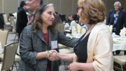 Community member congrats Assemblymember on her rewards.